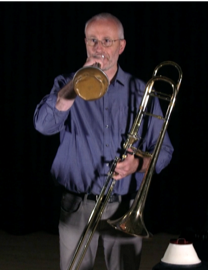 Andrew Digby demonstrates 'mouth piece (mute)'.