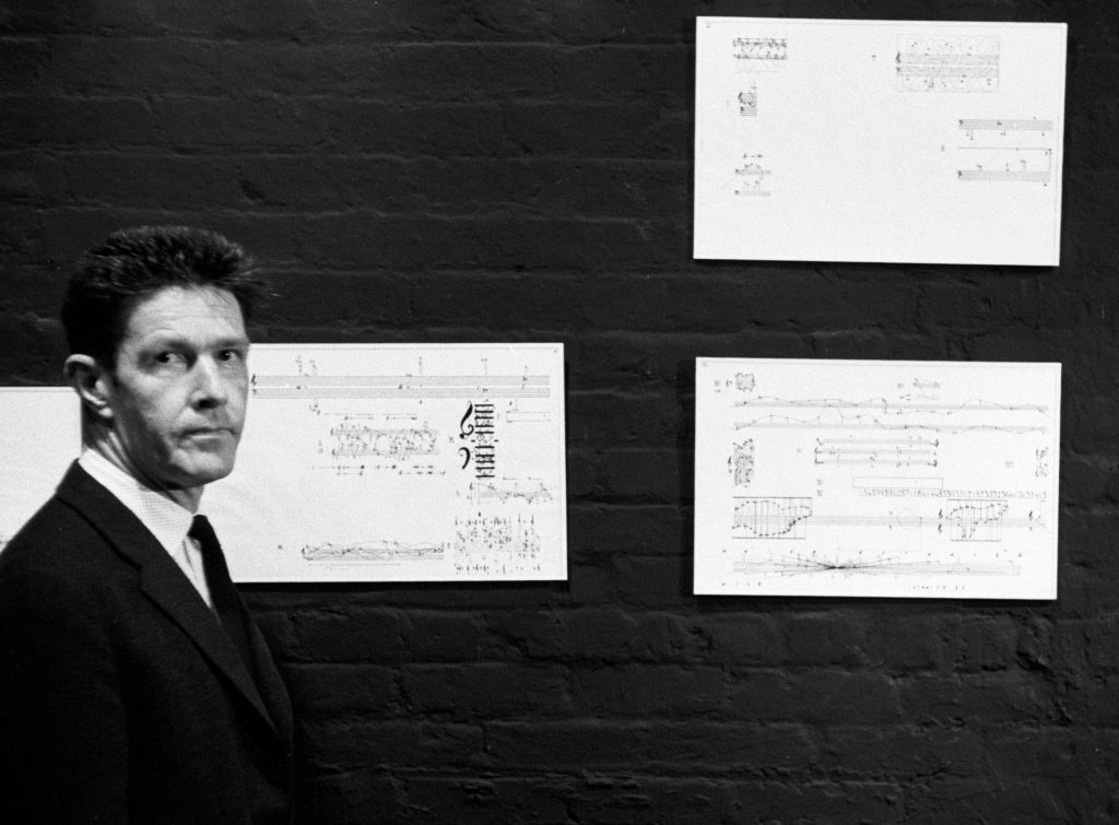 John Cage, pictured with pages from the <em>Solo for Piano</em>, New York City (1958) (Phillip Harrington / Alamy Stock Photo)